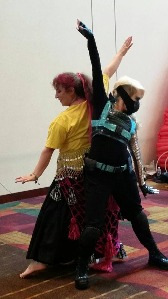 Margaret and Verna performing a duet at Gen Con 2014. Photo by Rebekah.